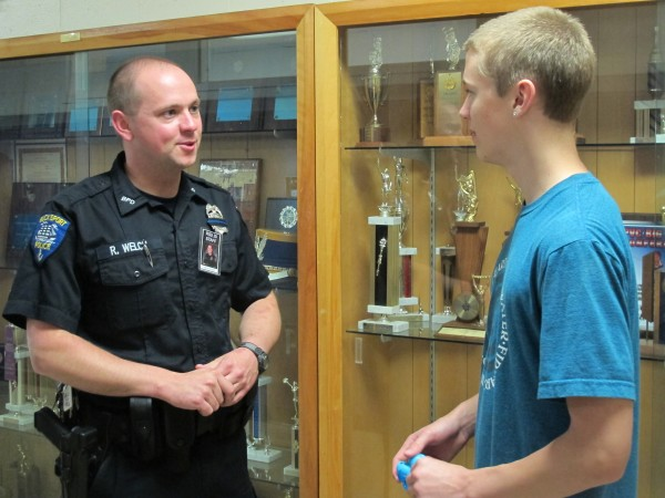 Bucksport School Resource Officer Ryan Welch stops Dalton Everett, a sophomore at Bucksport High School, in the hallway after school on Wednesday, May 15, 2013.