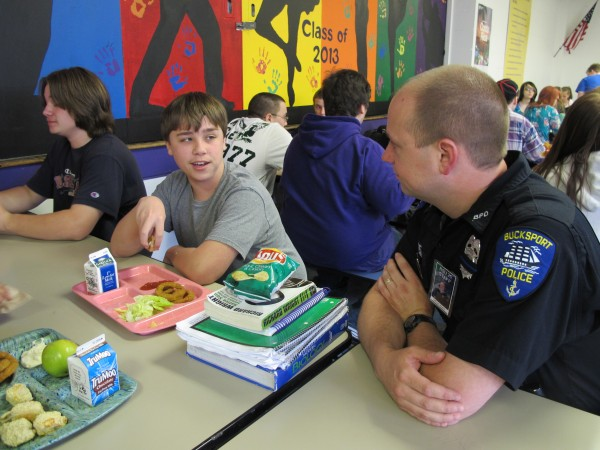 School Resource Officer Ryan Welch, right, chats with Bucksport High School students Tyler Young, center, and Zach Chapman, left, on Thursday, May 16, 2013.