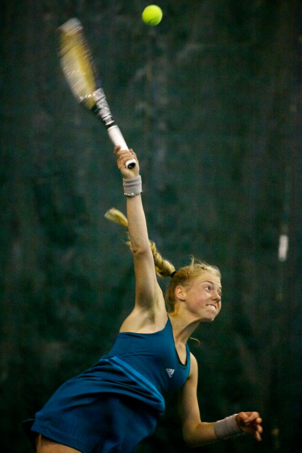 Olivia Leavitt of Falmouth High School serves in the finals match at the Maine Principals Association Singles Tennis Championship at the Racket and Fitness Center in Portland on Wednesday.