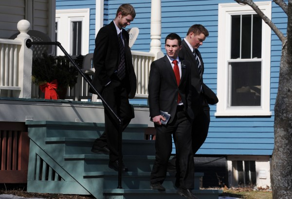 Mormon missionaries Tim Gunnel (from left) of Hampden and Riley Woodruff and Paul Giles, both of Utah, walk away form a home in Bangor after not getting an answer at the door during missionary work in March. The Church of Jesus Christ of Latter-day Saints has lowered the age at which missionaries can start a mission from 19 to 18. Gunnel, 18, will begin his mission in New Mexico shortly.