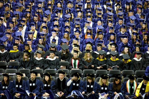 Students of the University of Maine attend the 2013 graduation ceremony at Alfond Arena in Orono Saturday, May 11, 2013.