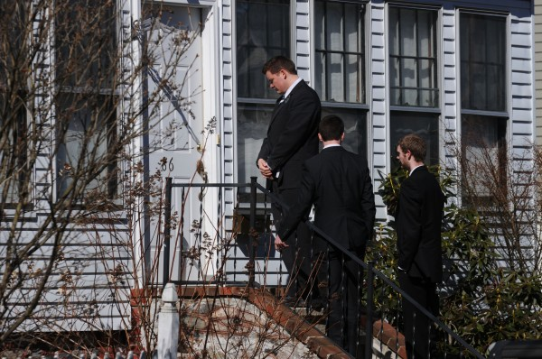Mormon missionaries Paul Giles and Riley Woodruff, both of Utah, and Tim Gunnel of Hampden wait on the door step for the homeowner to answer their knock on the door while in missionary work in Bangor in March. The Church of Jesus Christ of Latter-day Saints has lowered the age at which missionaries can start a mission from 19 to 18. Gunnel, 18, will officially begin his mission in New Mexico shortly.