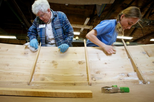 South Bristol eighth-grader Jordan Farrin, 13, works alongside volunteer Kate Beaudette in the boat shop at the Maine Maritime Museum in Bath on Friday.
