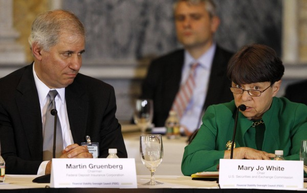 Mary Jo White, Chair of the Securities and Exchange Commission (right) and Martin Gruenberg, Chairman of the U.S. Federal Deposit Insurance Corporation (left) attend the Treasury Department's Financial Stability Oversight Council in Washington April 25, 2013.