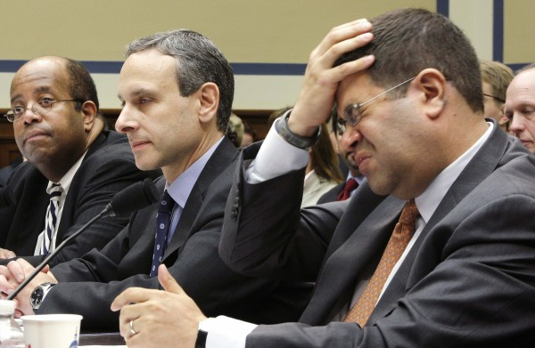 U.S. Deputy Treasury Secretary Neal Wolin, right, rubs his head during a lengthy hearing with U.S. Treasury Inspector-General for Tax Administration J. Russell George, left, and former IRS Commissioner Douglas Shulman, second from left, as they testify before a House Oversight and Government Reform Committee hearing on targeting of political groups seeking tax-exempt status from by the IRS, on Capitol Hill in Washington on May 22, 2013.