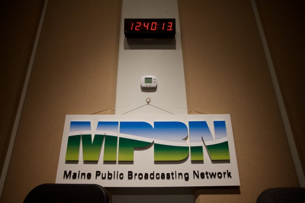 A clock announces the time in the Maine Public Broadcasting radio studio in Portland Tuesday.