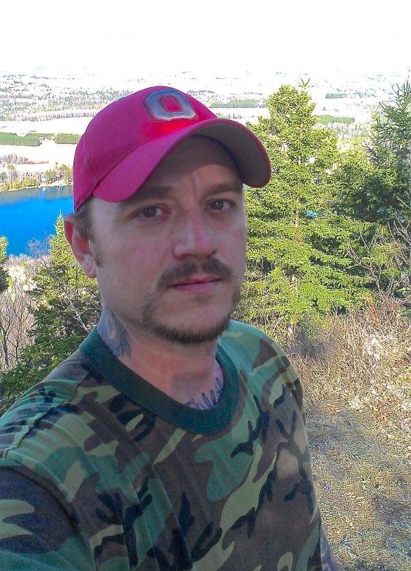 Thomas Peers of Caribou pauses for a photo at the summit of Quaggy Jo Mountain during spring 2013 in Aroostook State Park while getting into shape for hiking the Appalachian Trail to raise funds and awareness for the Wounded Warrior Project.