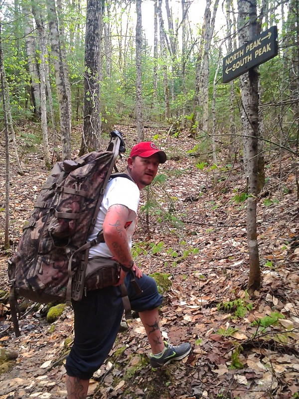 Thomas Peers of Caribou hikes to the peaks of Quaggy Jo Mountain during spring 2013 in Aroostook State Park to prepare for hiking the Appalachian Trail to raise funds and awareness for the Wounded Warrior Project.