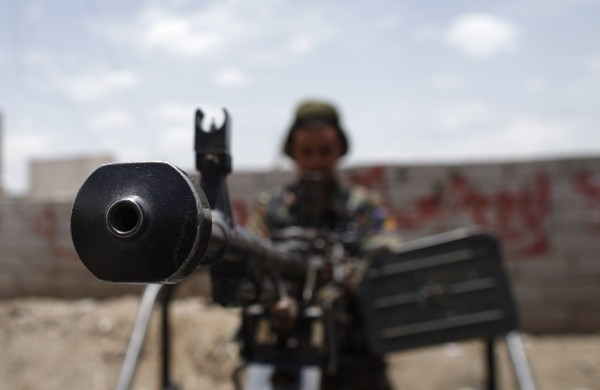 A member of Yemen's newly formed Special Security Forces holds a machinegun mounted on a patrol vehicle positioned at a checkpoint in Sanaa May 5, 2013.
