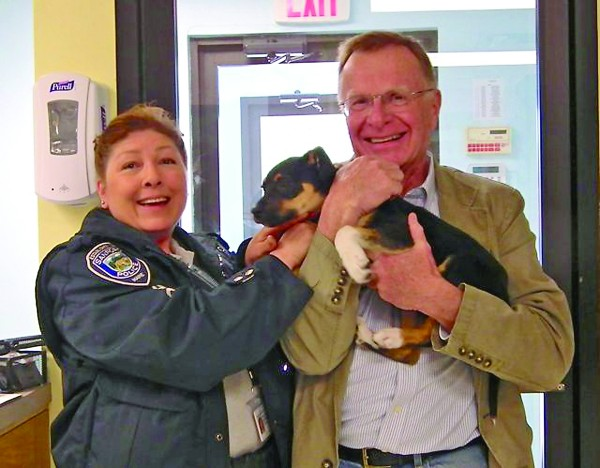 Sanford Animal Control Officer Lauren Masellas and Animal Welfare Society Executive Director Steve Jacobsen celebrate the return of a stolen puppy to the society's Kennebunk facility last week.