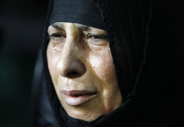 The mother of Qusay Ghazi Abboud, one of five soldiers killed by militants last week, cries during a memorial ceremony in Baghdad May 5, 2013.