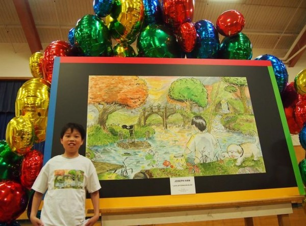 Joseph Han, an eighth-grader at Falmouth Middle School, on Wednesday morning with his artwork that was selected by Google for its Doodle 4 Google contest.