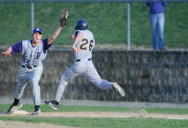 Hampden Academy's Andrew Knight makes the catch at first base to get out Mt. Blue's Jacob Barker on Wednesday, May 8, 2013.