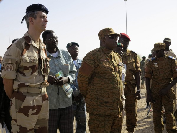Brigade General Gregoire de Saint-Quentin, head of Operation Serval in Mali, stands with General Nabere Honore Traore, army chief of Burkina Faso, during a handover ceremony of the Timbuktu mission from France to Burkina Faso at Timbuktu airport April 23, 2013. France intervened dramatically in January against Islamist rebels controlling Mali's north, saying they were a threat to Western security.