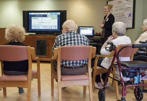 Residents in Longview assisted living at Christian Health Care Center in Wyckoff, N.J., play Hangman during a morning activity with Cheryl Wolf, director of activities, standing on right, March 6, 2013.