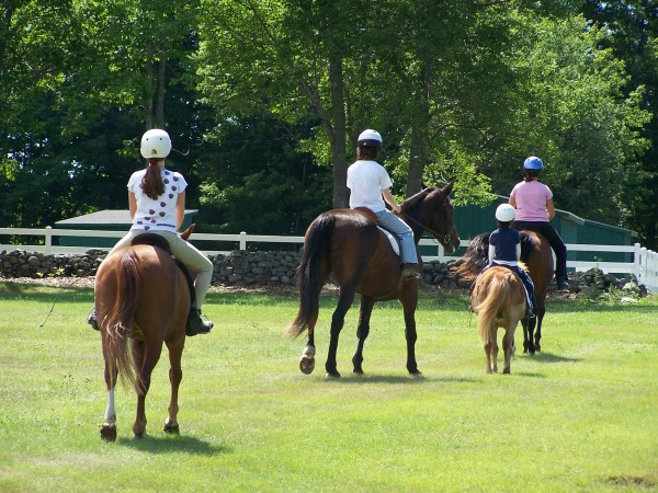 Pairing horses with riders is a complicated game, and the relative size of each is only part of the equation. These riders participated in a camp at Wild Ivy Farm in Bangor several years ago.