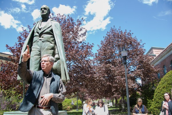 Tom McCord, a history and urban planning instructor at the University of Maine Augusta, leads a walking tour in front of the Hannibal Hamlin statue in downtown Bangor on Wednesday, May 15. McCord lead the tour with Bangor city councilman Ben Sprague. &quotWe really were just trying to show all the great things that are happening in dowtown Bangor. It's really becoming a dynamic community,&quot said Sprague.