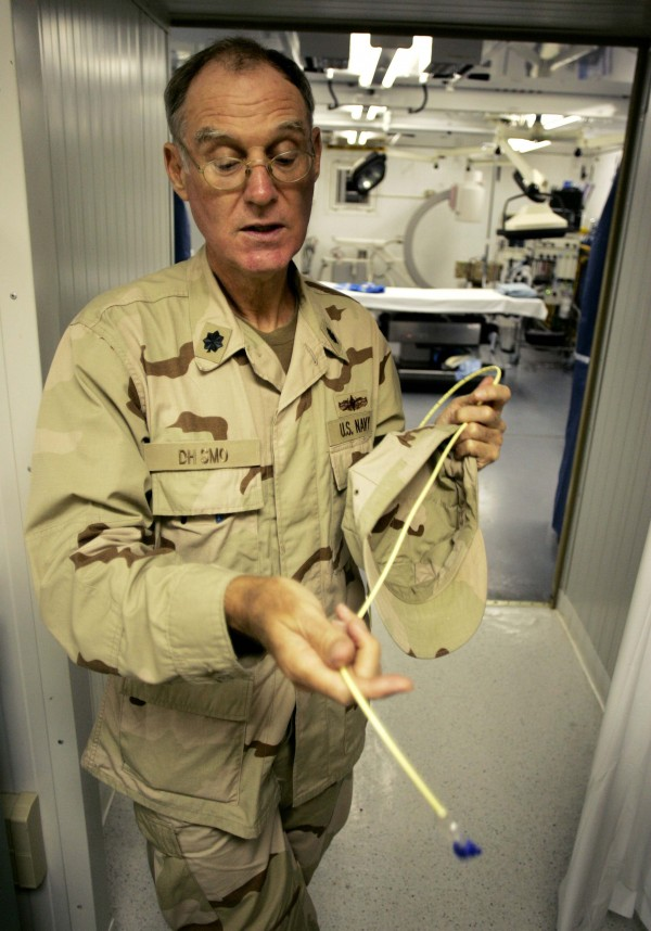 The senior medical officer who asked to not be identified holds a feeding tube as he explains treatment of detainees who hunger strike at Camp Delta at the Guantanamo Bay Naval Station in Guantanamo Bay, Cuba, in this file photo taken September 4, 2007.