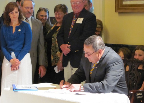 Gov. Paul LePage signs a bill in 2011 that will allow charter schools in Maine. LePage said Maine is the 41st state with a charter school bill on the books.