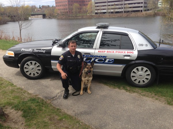 Westbrook Police Officer Phil Robinson and his K9 Roxie were credited with saving a suicidal woman who ran into the woods off Andover Road in Westbrook.