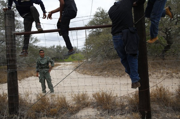 People are taken into custody by the U.S. Border Patrol near Falfurrias, Texas March 29, 2013.