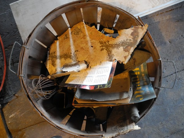 This basket contains some of the objects Seth Thayer and Greg Tinder have found while renovating a large downtown Belfast building. &quotIt's our archives,&quot Thayer said.