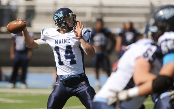 UMaine's Daniel Collins looks to pass the ball during the Maine Black Bear Football 2013 Jeff Cole Scrimmage on Saturday in Orono.
