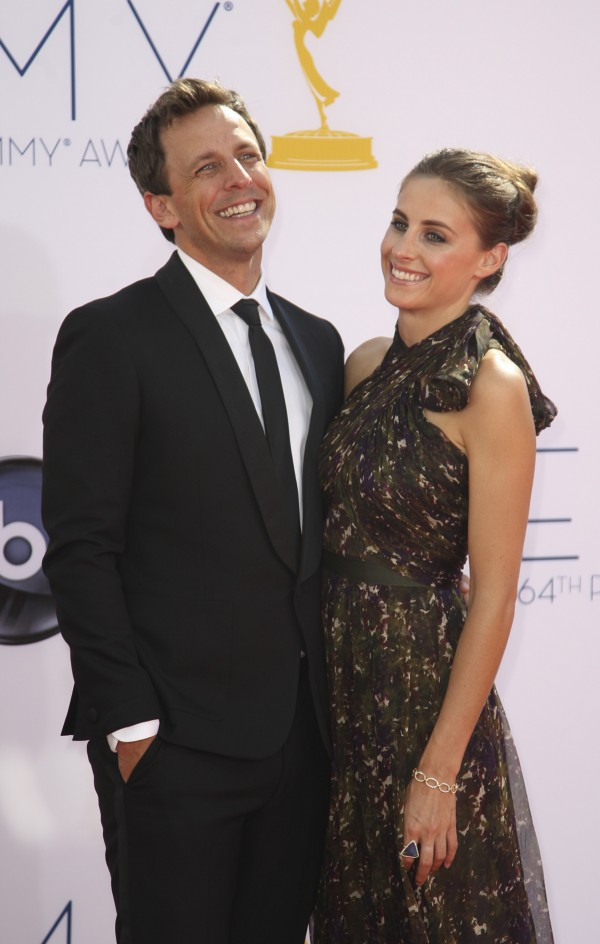 Seth Meyers (left) and Alexi Ashe right arrive at the 64th Annual Primetime Emmy Awards in Los Angeles on Sept. 23, 2011. NBC has announced that Meyers will succeed Jimmy Fallon as host of &quotLate Night.&quot