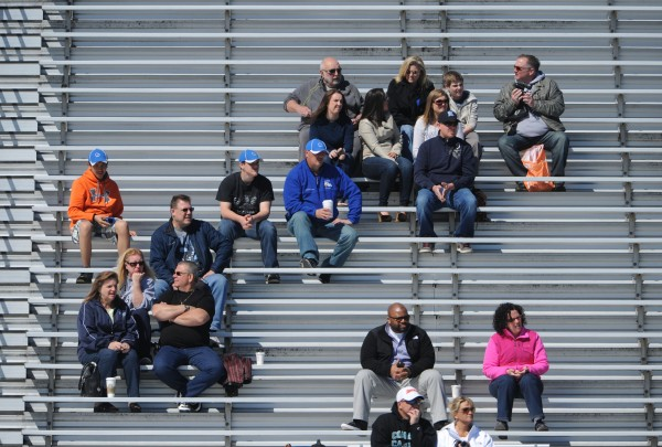 Family and fans of UMaine football watch from the stands during the Maine Black Bear Football 2013 Jeff Cole Scrimmage on Saturday in Orono.