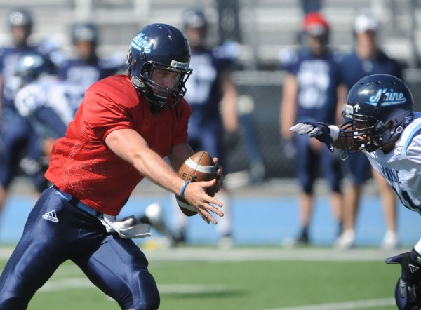 UMaine's Marcus Wasilewski hands the ball off to running back Nigel Jones during the Maine Black Bear Football 2013 Jeff Cole Scrimmage on Saturday in Orono.