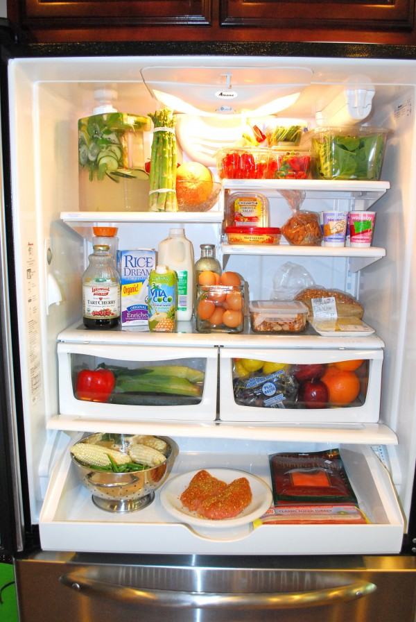 Fitness expert LaTasha Lewis recommends cleaning out the refrigerator and putting the healthiest items in spots where you can see them and grab them easily.