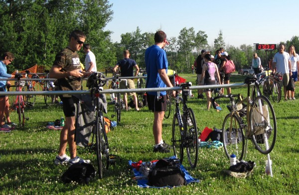 Racers in the Tri Aroostook triathlon in Presque Isle prepare their bicycles in the race's transition area on June 30, 2012.