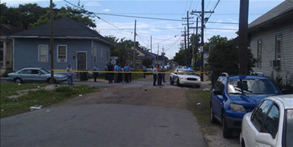 New Orleans Police Department members are seen at the site where at least 12 people were shot during a Mother's Day parade in New Orleans, La., on Sunday.