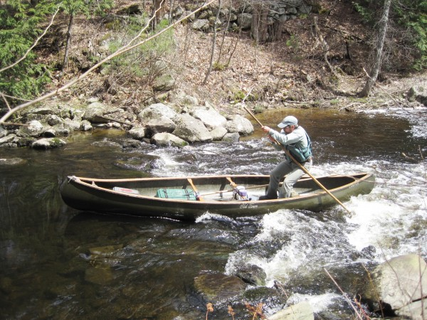 Mike Patterson poles a canoe up and over a drop on the Passagassawakeag River during a recent canoe poling clinic.