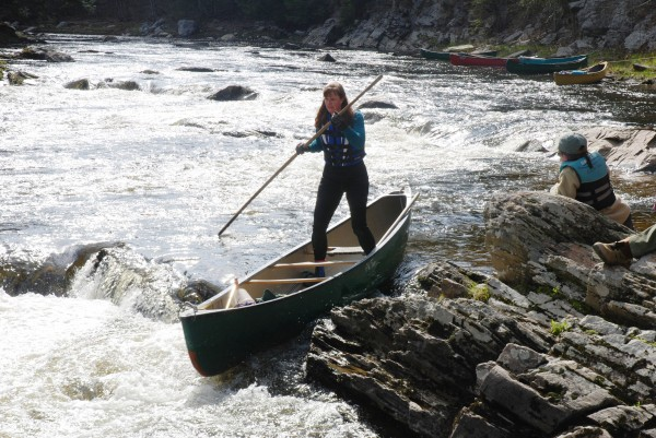 Canoeist Cynthia Morgan shifts her weight and uses a setting pole as she descends a series of drops on the Marsh Stream during a recent canoe poling clinic.