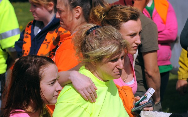 Kristine Wiley (center), Nichole Cable's mother, spoke to searchers briefly Sunday morning in Glenburn.