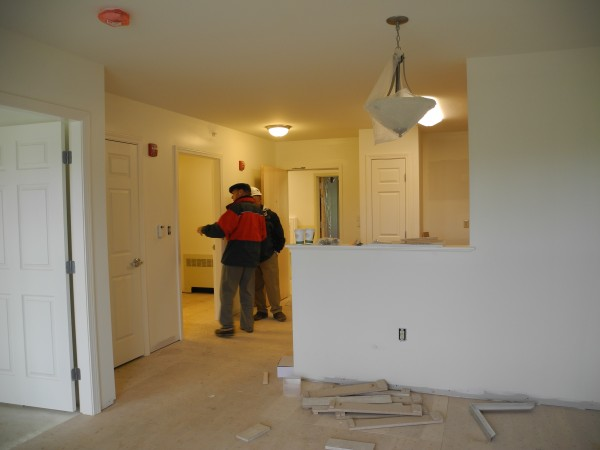 Project officials check out one of the units in the Goose River Apartments complex on Wednesday, May 22. The 24-unit project still under construction on Swan Lake Avenue should be ready for income-eligible seniors to move in later this summer.