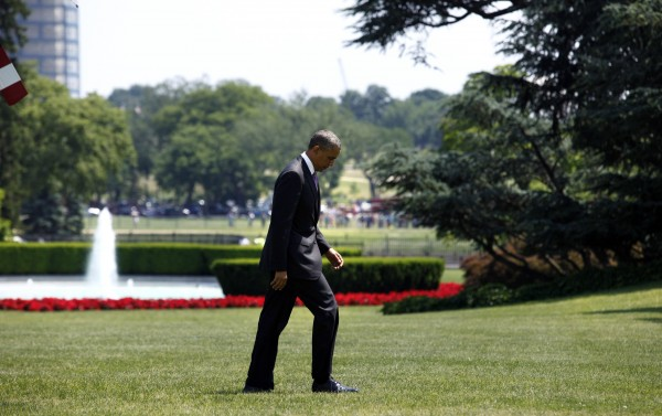 U.S. President Barack Obama walks on the South Lawn of the White House upon his return to Washington from Chicago May 30, 2013.