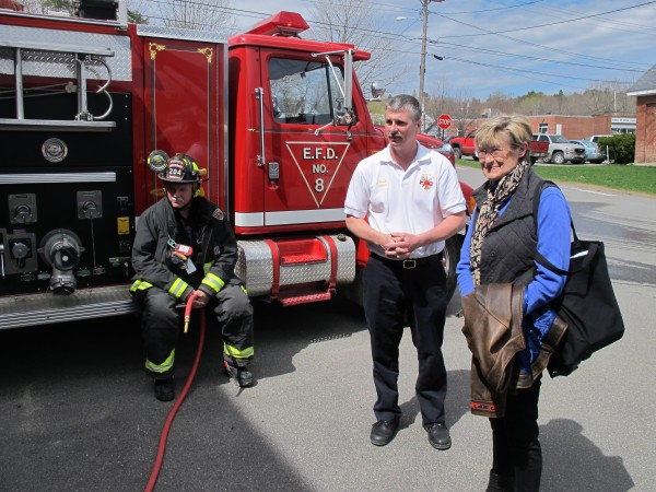 Dr. Susan Shaw (right) of Marine Environmental Research Institute, meets with Ellsworth Fire Chief Richard Tupper (center) and Lt. Gary Saunders on May 2, 2013. Shaw recently published a report that showed dangerous levels of flame retardant chemicals and their toxic byproducts in firefighters' blood.