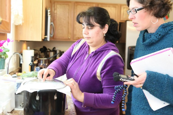 Lindsay Sterling of Freeport (right) learns how to cook Azerbaijani beef with sour plums and chestnut with home cook Zemfira Ahmadov, as part of her Immigrant Kitchens food writing project.