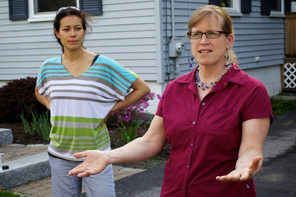 Deb Breiting (left) and Linda Braley express concerns over possible school redistricting while talking with neighbors on Edwards Street in Portland's Libbytown neighborhood Thursday evening.