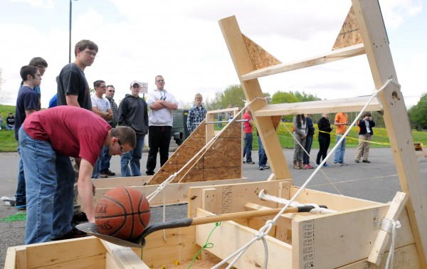 Brewer High School and United Technology Center students fired off a couple catapults that were built as part of a math project Tuesday.