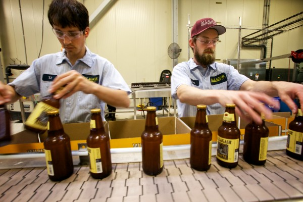 T.Z. Caron (left) and Ben Michaud box up bottles of Allagash White, the namesake brewing company's flagship beer, in Portland on Wednesday.