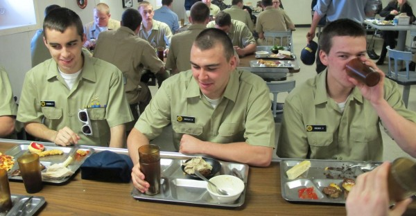 Maine Maritime Academy Freshmen Sean O'Connor, Brian Bentley and Eric Cressey eat lunch in one of messes aboard the Training Ship State of Maine.
