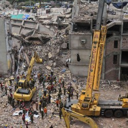Woman survives 17 days in collapsed Bangladesh garment factory where over 1,000 died