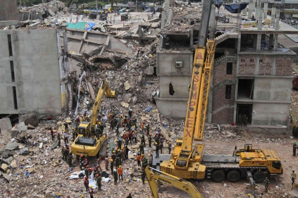 Rescue workers attempt to find survivors from the rubble of the collapsed Rana Plaza building in Savar on May 1, 2013