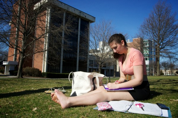 University of Southern Maine psychology student Casey Swenson prepares for an exam on the lawn in front of the science building on the Portland campus Thursday afternoon March 22, 2012.