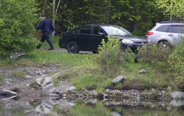 Police vehicles fill a small parking area on the east side of the Stillwater River near the intersection of Bennoch Road and Gilman Falls Avenue in Old Town on Tuesday morning. According to a spokesman for the Maine Department of Public Safety, authorities discovered what they said is likely the body of missing Glenburn teen Nichole Cable.