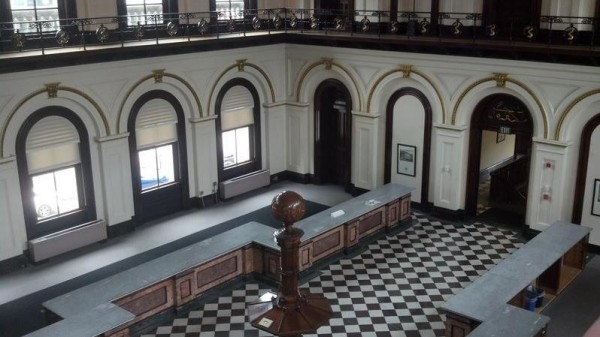 A view of Customs Hall inside the newly restored U.S. Custom House in Portland, from the second-floor balcony where armed guards once kept watch of merchants paying tariffs.