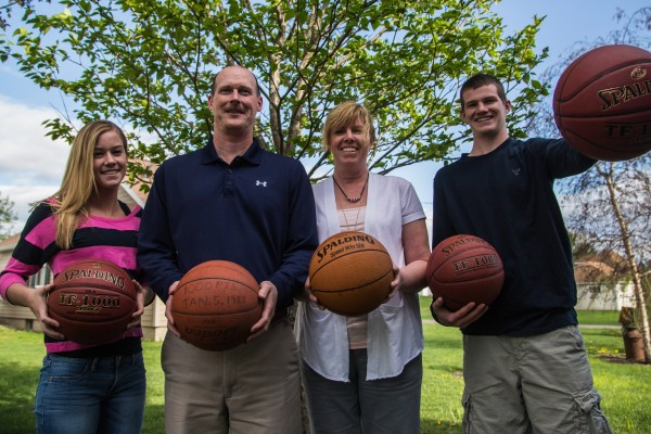 Sports have kept two generations of the Worcester family busy as they have competed successfully in several sports, including basketball, where each achieved the 1,000-point career scoring mark. Showing off their milestone basketballs are Mackenzie (from left), Larry, Kim and Mitch Worcester. Mitch scored more than 2,000 points.